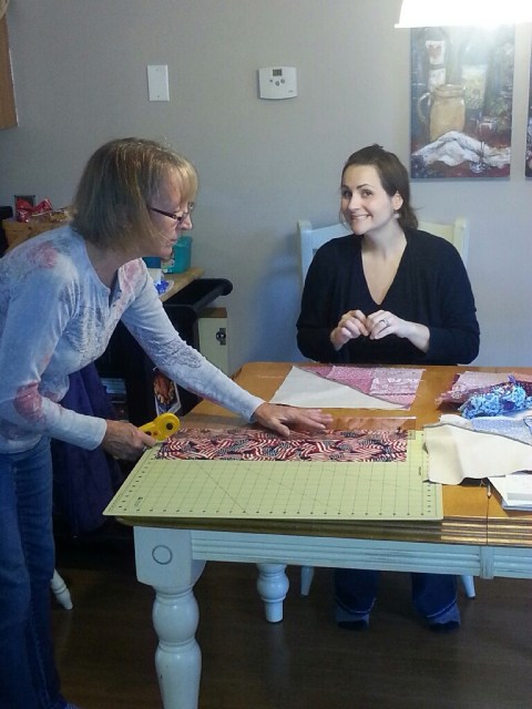 Lindsey pinning away and Mom slaving away at the cutting mat