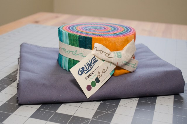 Win a jelly roll and 2 yards of grey fabric!