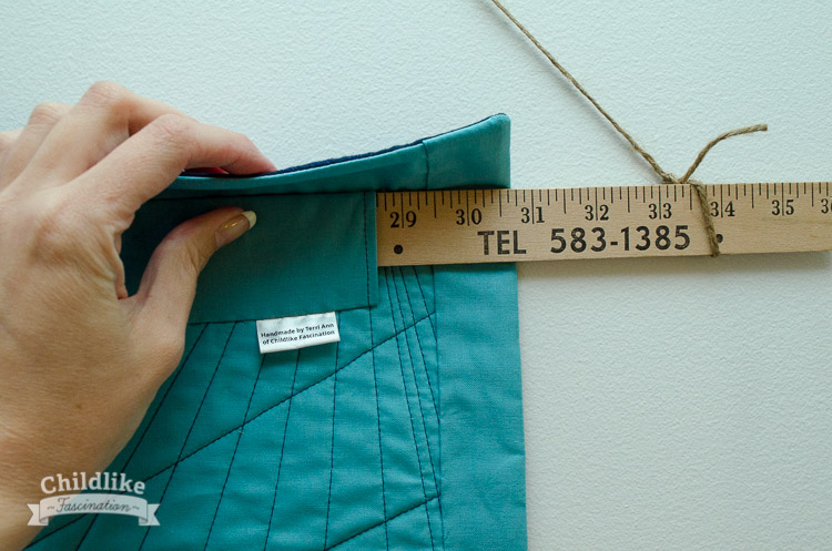A faced binding doesn't show on the front and let's the quilting extend to the edge - perfect for a wall hanging