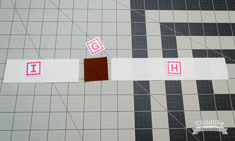 Sew the I and H pieces to opposite sides for the G block for the sailboat mast