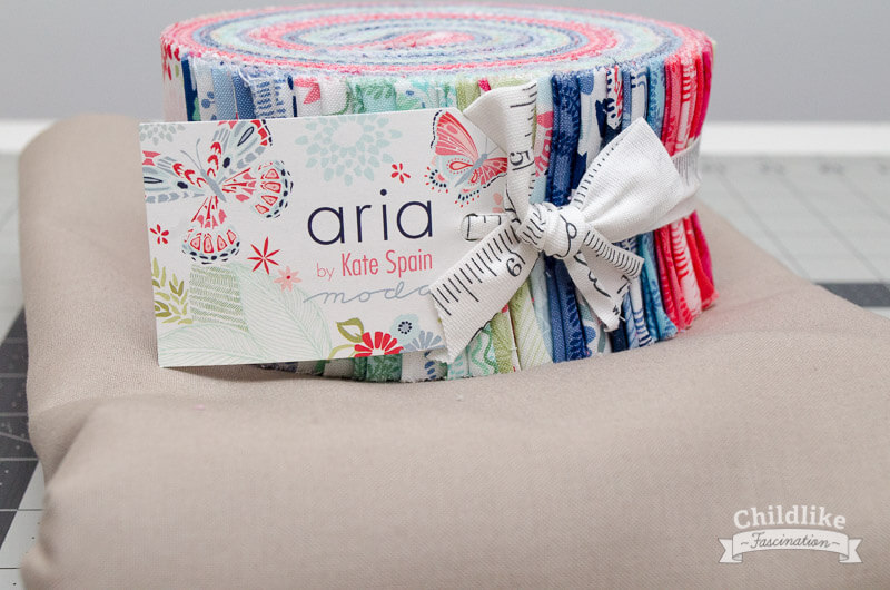 Aria Jelly Roll and Bella Stone Background Fabric