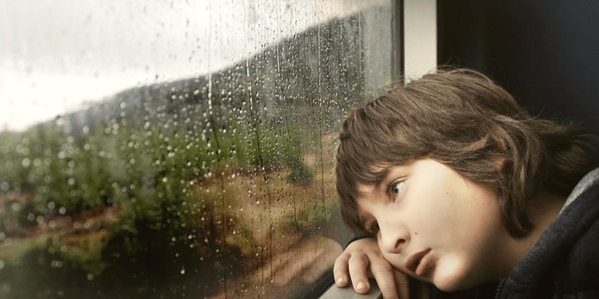 Sad child at window