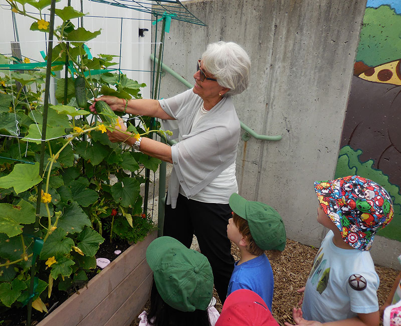 Ms. Helen Gardening with her Campers