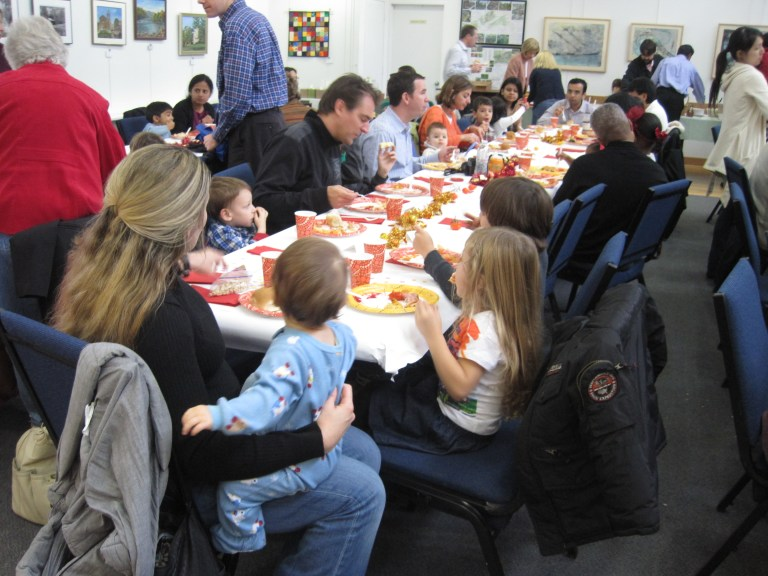 Families gather for Thanksgiving lunch Montessori school reston