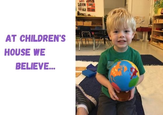 Child holding globe at Children's House Montessori School of Reston