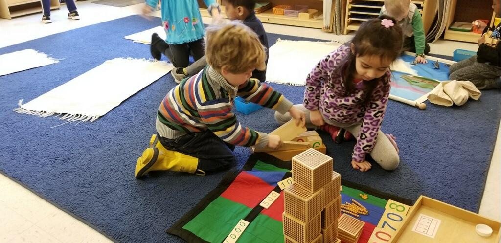 Two children working on Montessori work. Blog title image How to Find a Good Preschool