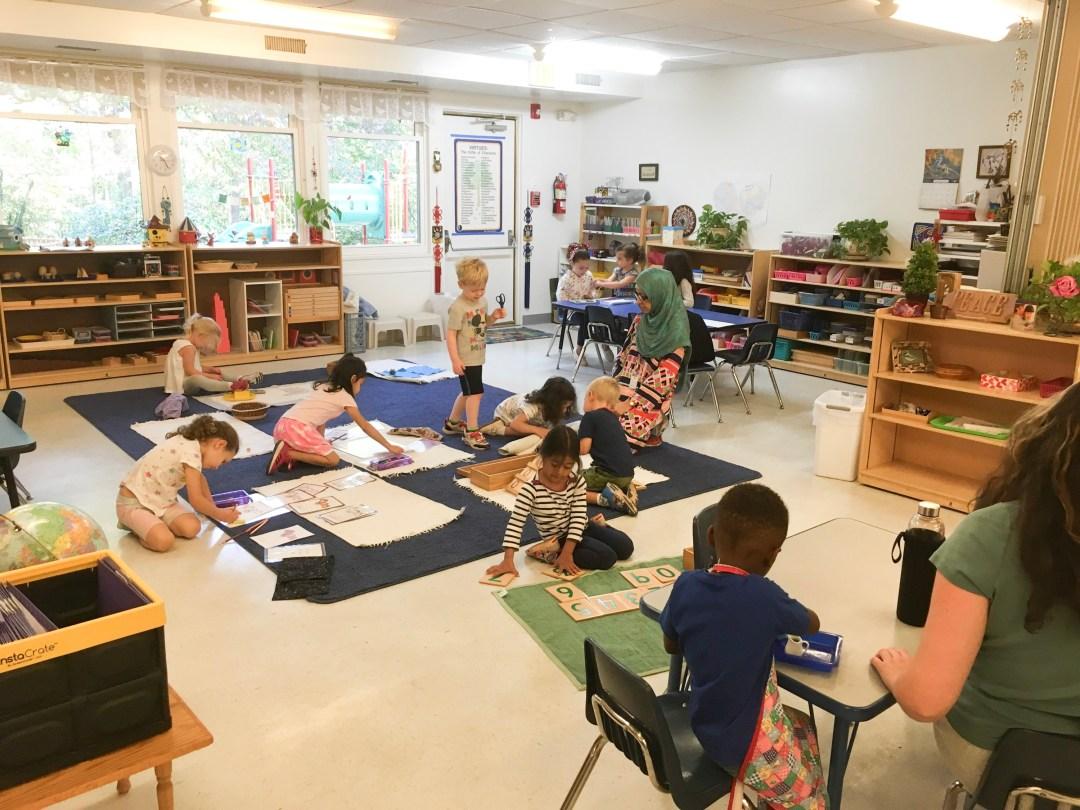 Busy classroom with children working at Children's House Montessori School.