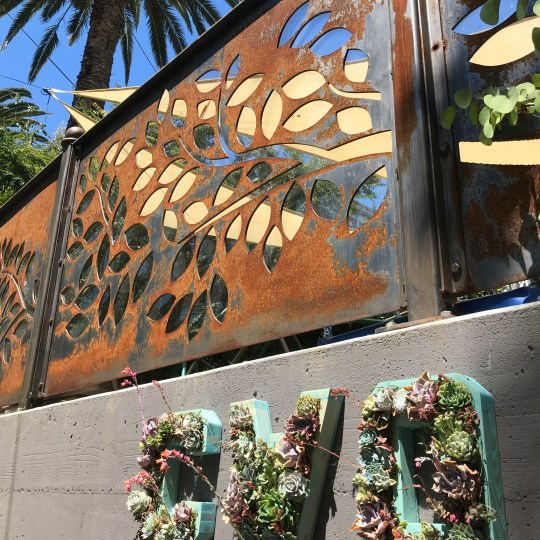 Our front garden is enclosed by nature-themed metal work designed by Friend of CWO, Mark Ruddy, to mimic the tree line we see while looking out our windows and playing in the yard.