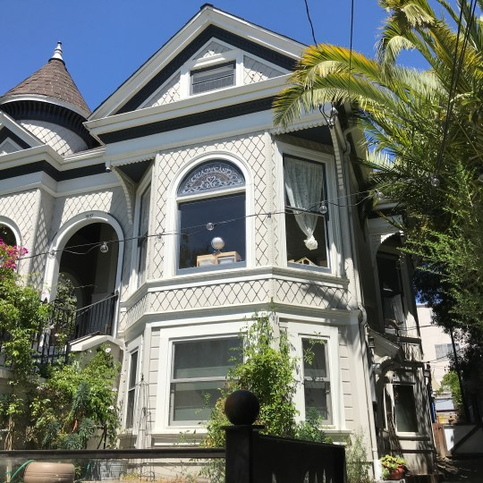 """The 8th Avenue campus is a registered historic landmark here in Oakland: #101 known as """"The Tower House"""". Built in 1898, this Queen Anne Victorian has been lovingly restored to meet the highest modern building, fire, safety and seismic standards. The structure and surrounding grounds are cared for by Jessica and her family and serve as a perpetual source of inspiration for the children and their teachers."""