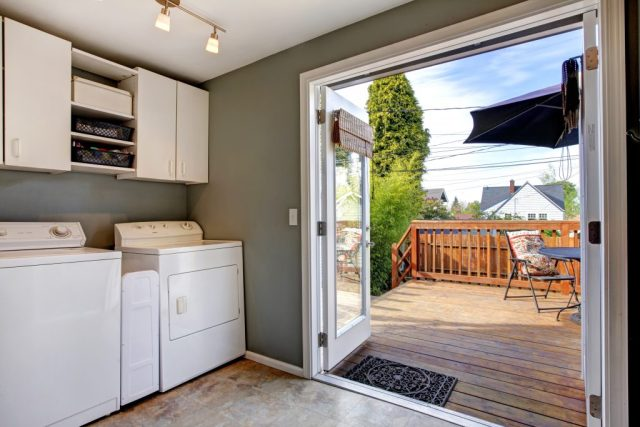 Make your kitchen fit for the whole family. A laundry room going out onto decking garden