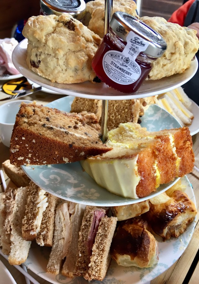 Lakeside Coffee House birthday afternoon tea a stand of cakes, scones, crisps and sandwiches