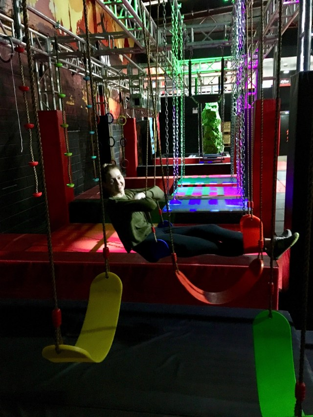 Ninja Adventure Preston review my friend is sat on a swing with her legs up in front of her an another swing