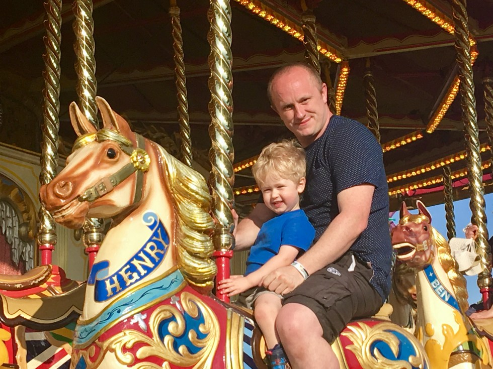 Geronimo Festival 2018 review D and Lucas looking at the camera sat on the horse merry go round