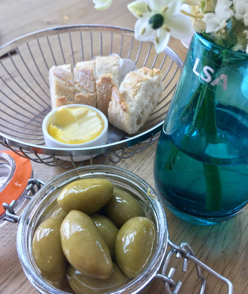 Wheelers of St. James, Liverpool review Green olives in a glass bowl, bread and butter in a silver basket