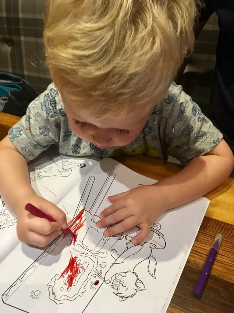 Spitroast, Liverpool review Lucas sat colouring