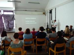 Eine Vortragssituation mit Publikum