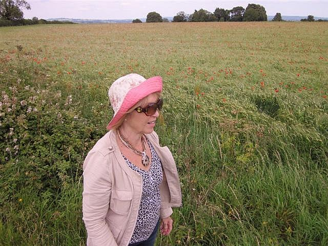 Gail Isaac in a poppy field high on a hill near Castle Cary, 2011 Photo by Peter Isaac