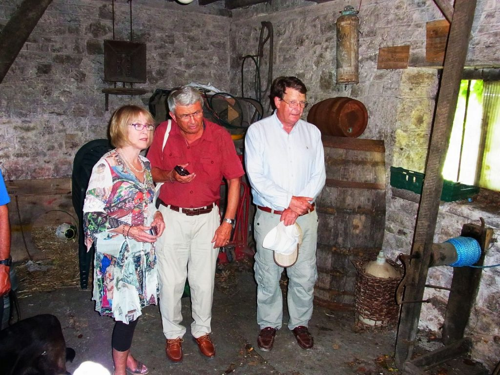 Gail Isaac, Edward Lutley and Peter Isaac in Nobby Kerton's cider press