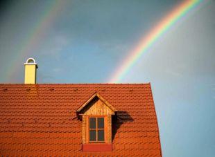 rainbow behind a house