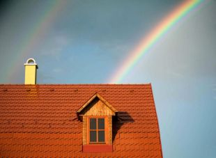 rainbow behind a house