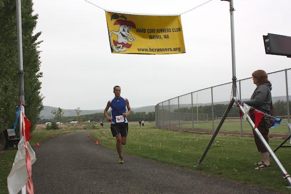 Kurtis crossing the finish line