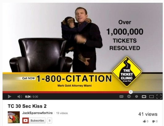 Screenshot of The Ticket Clinic's TV spot featuring a baby chimpanzee