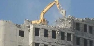 Demolishing a building from the top down