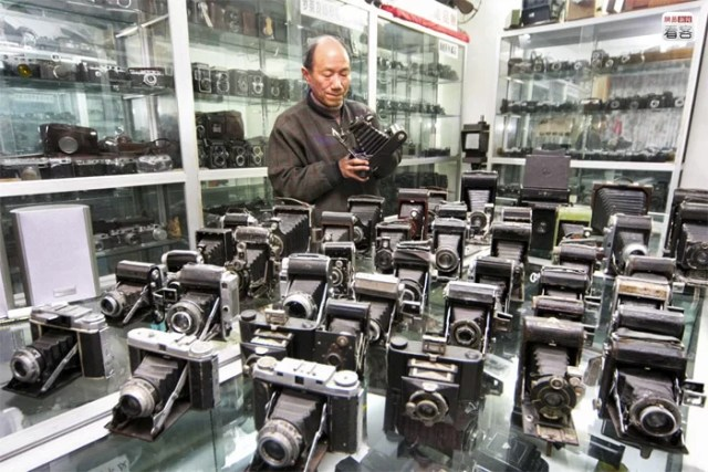 Hangzhou, a man showing his huge collection of cameras consisting of more than 1100 units