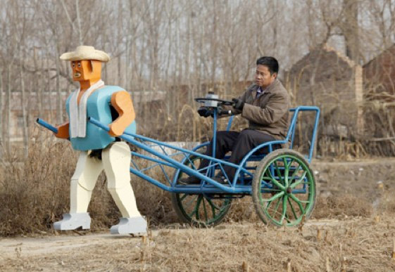 Wu Yulu, a farmer, built a robot to pull his cart