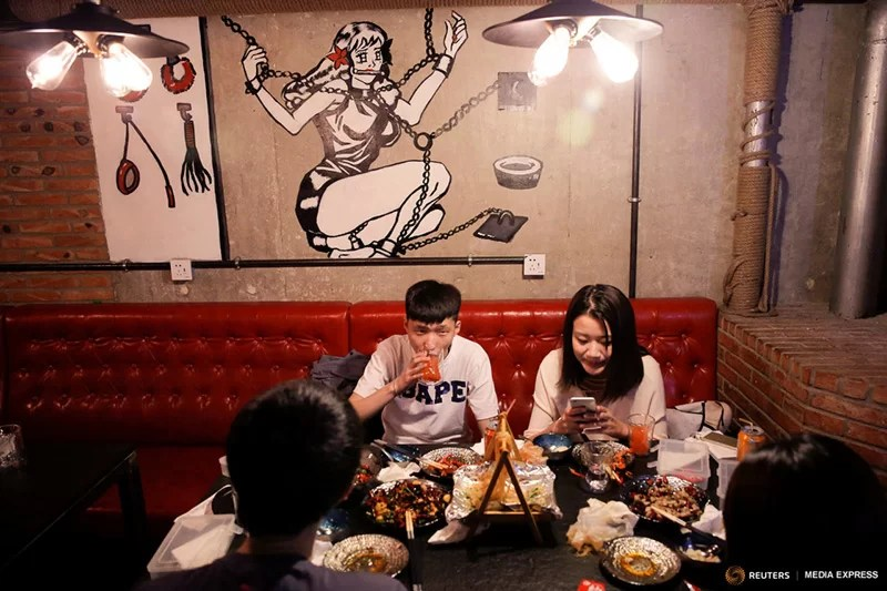 Beijing fetish restaurant teases with lobster and sex