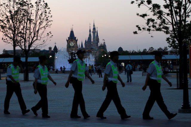 Policemen guard at Disney Town of Shanghai Disney Resort, during the first part of three-day Grand Opening events in Shanghai, China, June 14, 2016. REUTERS/Aly Song