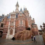 Staff walk at Shanghai Disney Resort during a three-day Grand Opening event in Shanghai