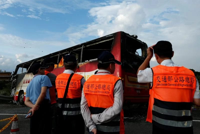 A bus carrying tourists from China which crashed into a highway railing en route to Taoyuan airport is seen, just south of the capital Taipei, Taiwan July 19, 2016. REUTERS/Tyrone Siu