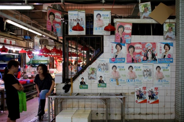 Candidates' campaign posters for the Legislative Council election are displayed at a market in Hong Kong, China August 17, 2016. Picture taken August 17, 2016. REUTERS/Bobby Yip