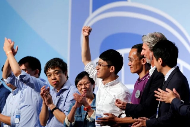 Nathan Law (4th R) celebrates after winning a seat in the Legislative Council election, in Hong Kong, China September 5, 2016. REUTERS/Tyrone Siu