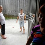 An injured woman and other villagers tell their experience after Tuesday's clashes between security forces and protesters in Wukan