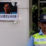 A portrait of the jailed Wukan village chief Lin Zuluan is displayed by protesters demanding the release of Lin outside China Liaison Office in Hong Kong, China September 14, 2016.      REUTERS/Bobby Yip