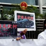 "Protesters demonstrate with placards which read ""Support Wukan village"" outside China Liaison Office in Hong Kong"