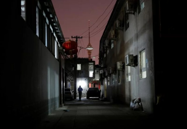 A man walks past the accommodation where some patients and their family members stay while seeking medical treatment in Beijing, China, April 21, 2016. REUTERS/Kim Kyung-Hoon