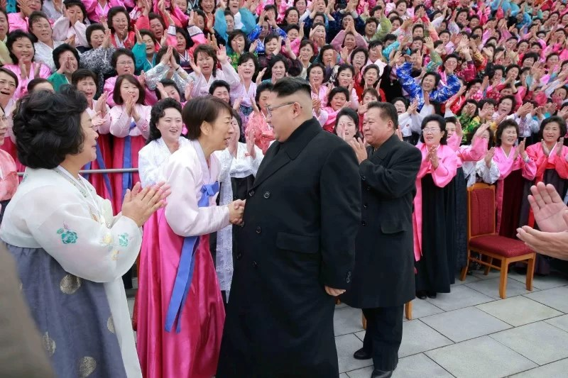 North Korean leader Kim Jong Un takes part in a photo session with the participants of the 6th Congress of the Democratic Women's Union of Korea in this undated photo released by North Korea's Korean Central News Agency (KCNA) in Pyongyang