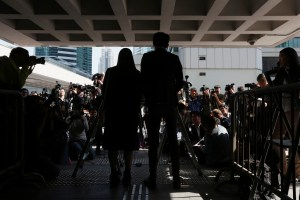 Pro-independence activists Yau Wai-Ching (L) and Baggio Leung meet journalists outside High Court after they lost an appeal against their disqualification as lawmakers in Hong Kong, China November 30, 2016.  REUTERS/Bobby Yip