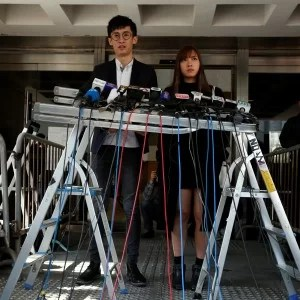 Pro-independence activists Yau Wai-Ching (R) and Baggio Leung meet journalists outside High Court after they lost an appeal against their disqualification as lawmakers in Hong Kong, China November 30, 2016. REUTERS/Bobby Yip