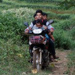 People drive their motor bike as they travel outside Pansang, Wa territory in northeast Myanmar