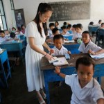 A teacher conducts a Chinese language lesson in a school in Namtit, Wa territory in northeast Myanmar