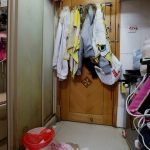 The kitchen and toilet of a 100-square-foot sub-divided unit is seen in Hong Kong