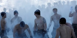 South Korean and U.S. Marines hurl snow as they participate in a winter military drill in Pyeongchang