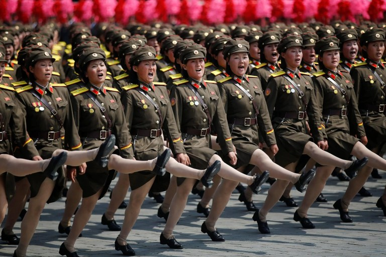 North Korean soldiers march and shout slogans during a military parade marking the 105th birth anniversary of country's founding father in Pyongyang_North Korea new missiles