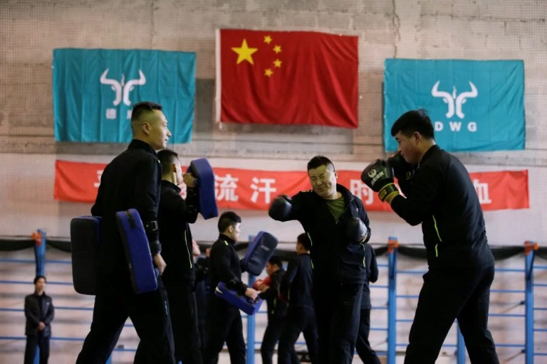 Trainees from Dewei Security attend boxing training at a training camp on the outskirts of Beijing