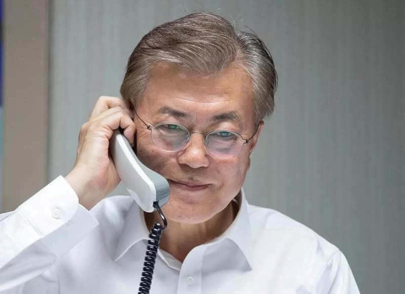 South Korean President Moon Jae-in speaks with U.S. President Donald Trump by telephone at his house in Seoul