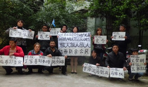 "This was the ""illegal assembly"" outside Liu Ping's apartment building one early evening in April, 2013."